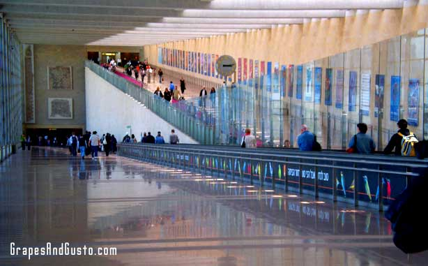 Ancient artifacts are displayed amid the sleek modernity of Israel's Lod Airport.