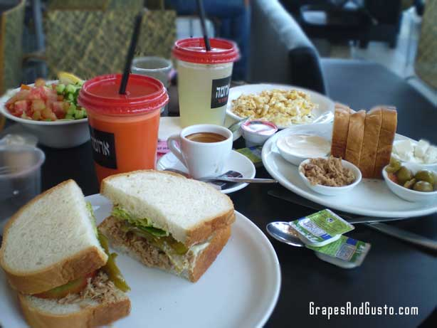 Typical breakfast fare at an Israeli cafe fare includes fresh, chopped salads, eggs, fresh-squeezed juices and sandwiches.