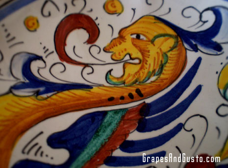 Hand-painted detail showing the Raffaellesco dragon
